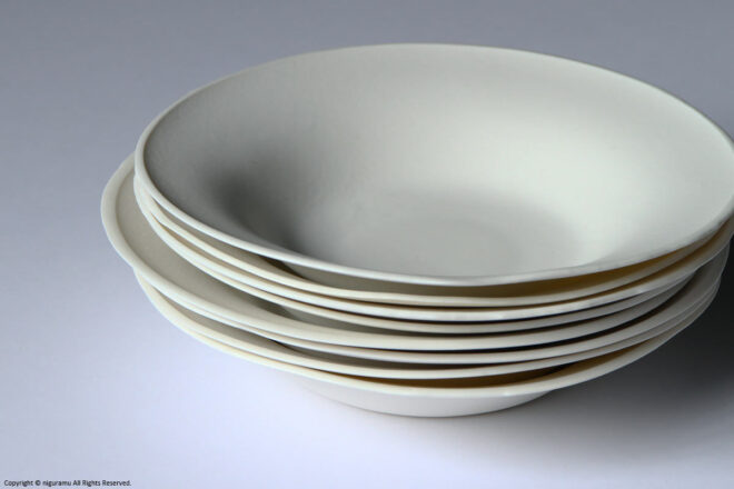 The dishes can be stacked, but the shape is different individually.