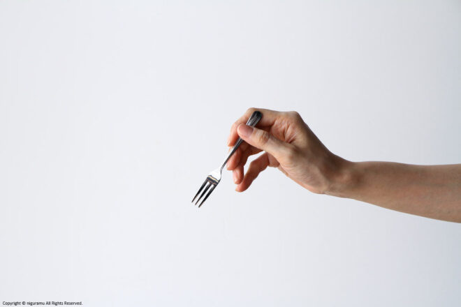 """Compare the size of the """"Deco, Cocktail Fork"""" and the hand."""