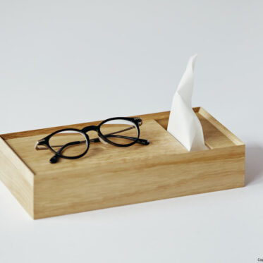 Place the glasses on the top tray of the tissue box.